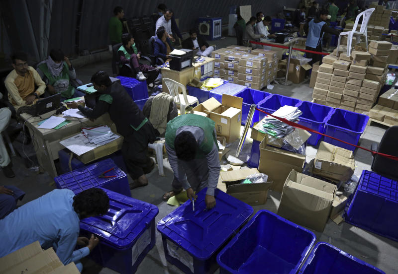 In this Monday, Oct. 15, 2018 photo, election workers secure ballot boxes ahead of parliamentary elections, in Kabul, Afghanistan. The elections are being held Saturday despite deep security concerns and ongoing fighting in as many as 20 out of the country's 34 provinces. The vote comes amid a particularly vicious campaign by the Taliban and the Islamic State group, which have been staging near-daily attacks and there have also been concerns over the transparency of the vote. (AP Photo/Rahmat Gul)