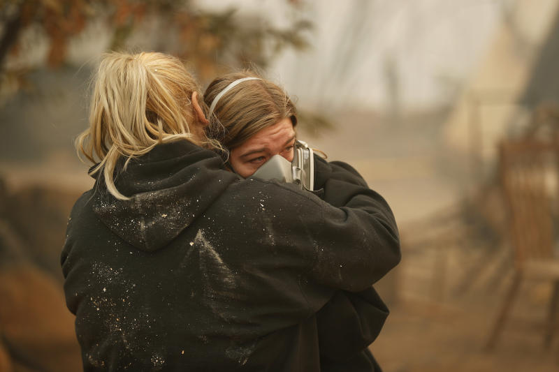 Krystin Harvey, left, comforts her daughter Araya Cipollini at the remains of their home burned in the Camp Fire, Saturday, Nov. 10, 2018, in Paradise, Calif. The Camp Fire is California's most destructive wildfire since record-keeping began. (ASSOCIATED PRESS)