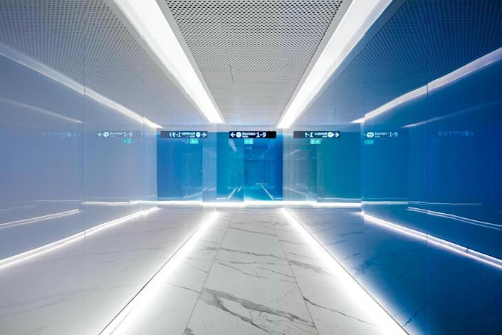 The hallways inside the VIP lounge are adorned my bold blue-green gradient walls.
