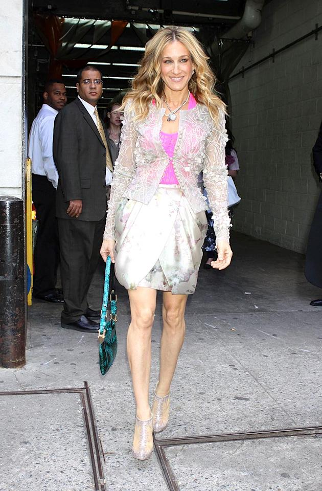 """Sarah Jessica Parker was recently spotted exiting a """"Sex and the City"""" press conference at Bergdorf Goodman in NYC in this daring getup. What do you make of SJP's Elie Saab ensemble? We secretly love every piece from the pink top to the lace cardigan, draped skirt, snakeskin bag, and Louboutin heels. Roger Wong/<a href=""""http://www.infdaily.com"""" target=""""new"""">INFDaily.com</a> - May 16, 2010"""