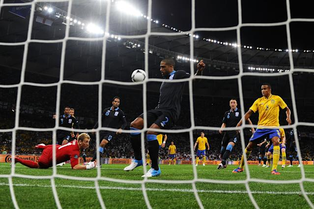 KIEV, UKRAINE - JUNE 15: Glen Johnson of England scores an own goal off of Olof Mellberg of Sweden effort during the UEFA EURO 2012 group D match between Sweden and England at The Olympic Stadium on June 15, 2012 in Kiev, Ukraine. (Photo by Laurence Griffiths/Getty Images)