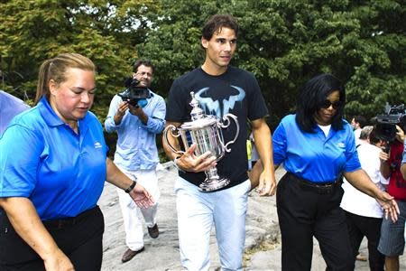 Nadal of Spain arrives with his trophy for a photo call after winning the men's singles final match against Novak Djokovic of Serbia at the U.S. Open tennis tournament in New York's Central Park