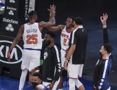 New York Knicks guard Immanuel Quickley (5) celebrates with forward Reggie Bullock (25) after making a 3-point basket against the Atlanta Hawks in overtime of an NBA basketball game Wednesday, April 21, 2021, in New York. (Wendell Cruz/Pool Photo via AP)