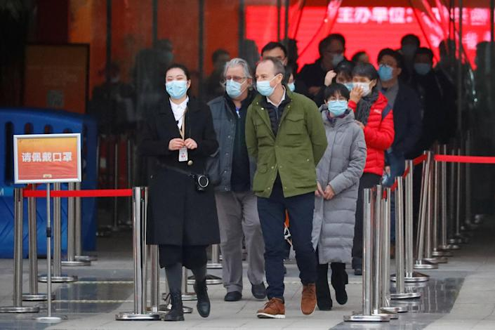Image: Members of the World Health Organisation (WHO) tasked with investigating the origins of the coronavirus disease (COVID-19) pandemic, leave an exhibition on how China fought the coronavirus in Wuhan, Hubei province, Chin (Thomas Peter / Reuters)
