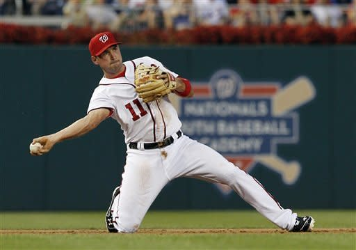 Washington Nationals third baseman Ryan Zimmerman throws out New York Mets' Kelly Shoppach during the second inning of a baseball game at Nationals Park on Friday, Aug. 17, 2012, in Washington. (AP Photo/Alex Brandon)