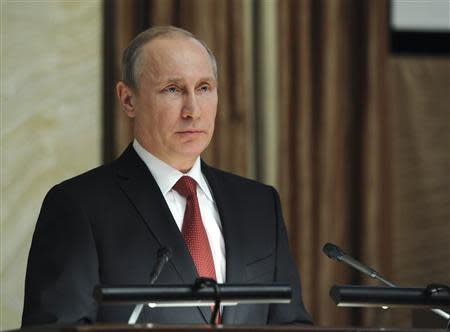 Russia's President Vladimir Putin delivers a speech during a session of the board of the FSB security service in Moscow April 7, 2014. REUTERS/Mikhail Klimetyev/RIA Novosti/Kremlin