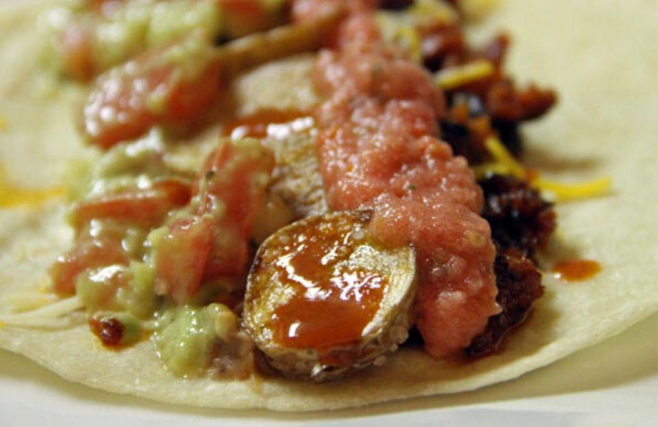 """<p>Order anything off a Mexican menu and prepare for it to almost always be paired alongside a mound of rice placed next to a pool of refried beans. A <a href=""""https://www.thedailymeal.com/classic-texas-recipes?referrer=yahoo&category=beauty_food&include_utm=1&utm_medium=referral&utm_source=yahoo&utm_campaign=feed"""" rel=""""nofollow noopener"""" target=""""_blank"""" data-ylk=""""slk:trademark Tex-Mex recipe"""" class=""""link rapid-noclick-resp"""">trademark Tex-Mex recipe</a> too, refried beans pair well with just about everything under the sun. </p> <p><strong><a href=""""https://www.thedailymeal.com/refried-beans-0?referrer=yahoo&category=beauty_food&include_utm=1&utm_medium=referral&utm_source=yahoo&utm_campaign=feed"""" rel=""""nofollow noopener"""" target=""""_blank"""" data-ylk=""""slk:For the Refried Beans recipe, click here."""" class=""""link rapid-noclick-resp"""">For the Refried Beans recipe, click here.</a></strong></p>"""