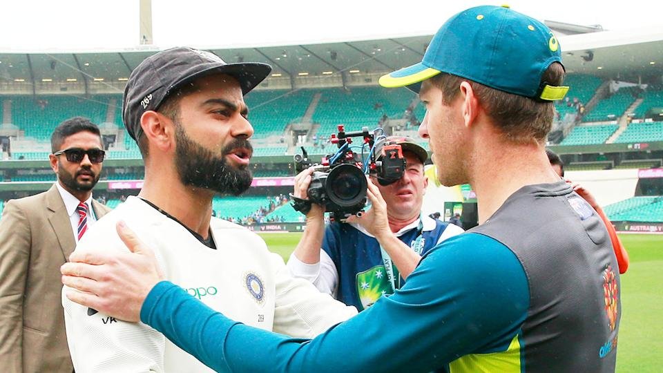 Indian captain Viart Kohli (pictured left) shakes hands with Australian captain Tim Paine (pictured right) at the SCG. (Getty Images)