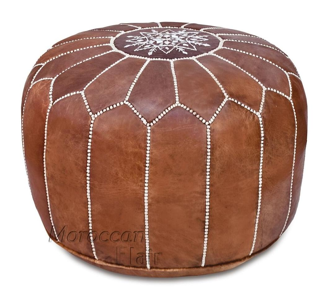 "<p><a href=""https://www.popsugar.com/buy/Moroccan-Flair-Leather-Moroccan-Pouf-Tan-505079?p_name=Moroccan%20Flair%20Leather%20Moroccan%20Pouf%20in%20Tan&retailer=amazon.com&pid=505079&price=170&evar1=casa%3Aus&evar9=46784503&evar98=https%3A%2F%2Fwww.popsugar.com%2Fphoto-gallery%2F46784503%2Fimage%2F46791572%2FMoroccan-Flair-Leather-Moroccan-Pouf-in-Tan&list1=shopping%2Camazon%2Cdecor%20shopping%2Chome%20shopping&prop13=api&pdata=1"" rel=""nofollow"" data-shoppable-link=""1"" target=""_blank"" class=""ga-track"" data-ga-category=""Related"" data-ga-label=""https://www.amazon.com/gp/product/B01N5T4KI3/ref=ppx_yo_dt_b_asin_title_o00_s00?ie=UTF8&amp;th=1"" data-ga-action=""In-Line Links"">Moroccan Flair Leather Moroccan Pouf in Tan</a> ($170)</p>"
