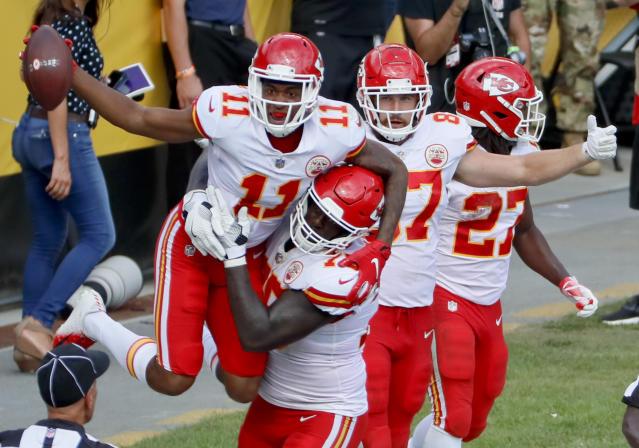 <p>Kansas City Chiefs wide receiver Demarcus Robinson (11) celebrates with teammates after making a touchdown catch against the Pittsburgh Steelers in the second half of an NFL football game, Sunday, Sept. 16, 2018, in Pittsburgh. The play was originally called an out-of-bounds catch, but the call was overturned on review and ruled a touchdown .(AP Photo/Gene J. Puskar) </p>