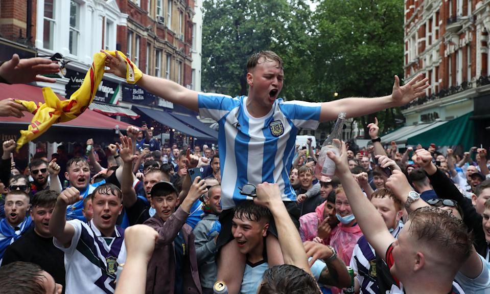 Scotland fans gather in Leicester Square before the UEFA Euro 2020 match between England and Scotland later tonight. (PA)