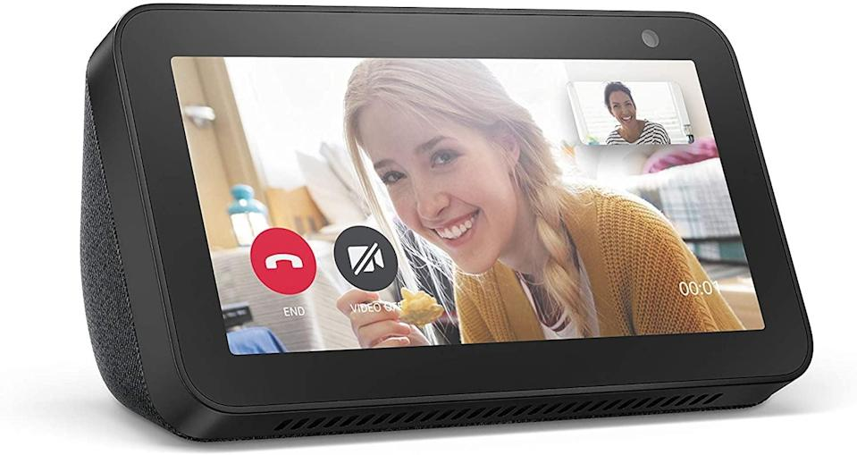 <p>From catching up with your favorite shows to staying conncected via video calling, the <span>Echo Show 5</span> ($45) will make doing household chores a lot better!</p>