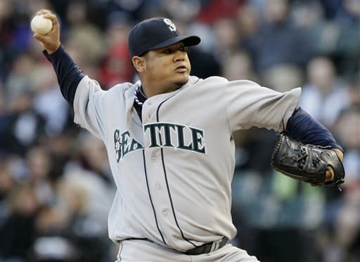 Seattle Mariners starter Felix Hernandez delivers a pitch during the first inning of a baseball game against the Chicago White Sox in Chicago, Friday, June 1, 2012. (AP Photo/Nam Y. Huh)