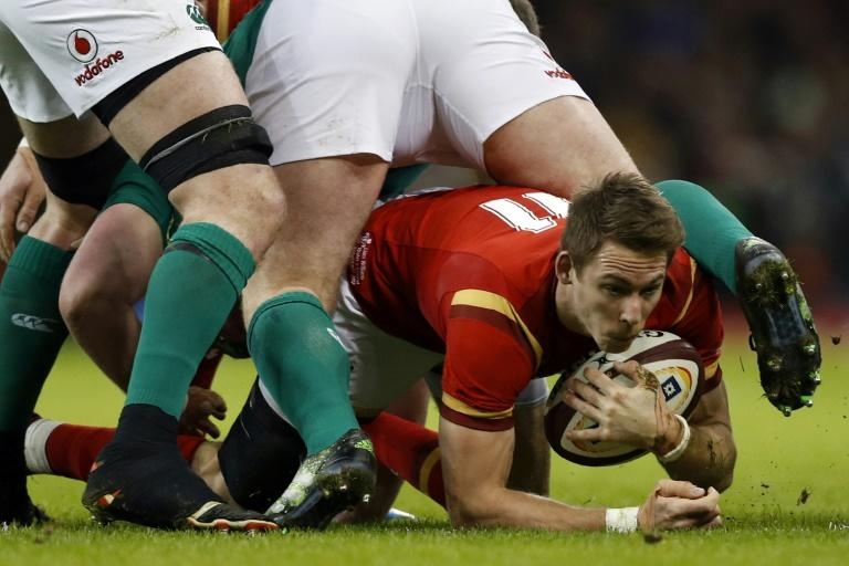 Wales' wing Liam Williams gathers the ball during the Six Nations international rugby union match between Wales and Ireland at the Principality Stadium in Cardiff, south Wales, on March 10, 2017