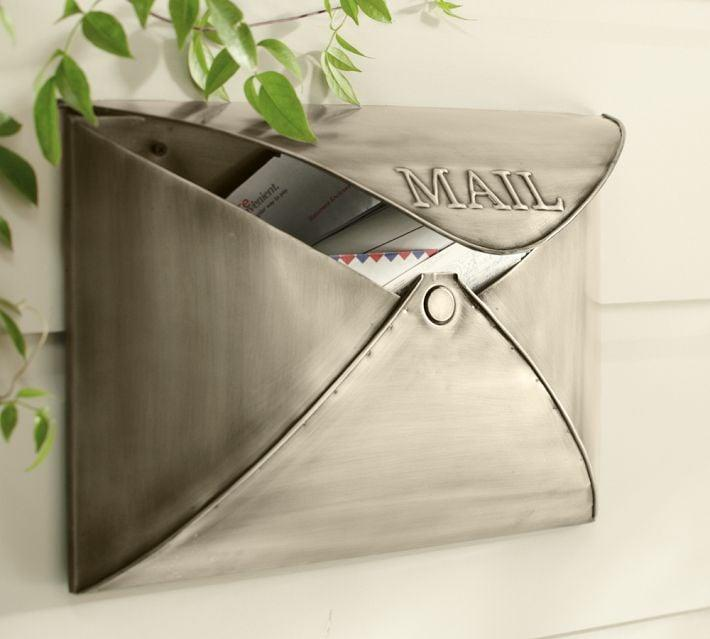 """<p>Update your current box with this vintage-inspired <product href=""""http://www.potterybarn.com/products/envelope-mailbox/"""" target=""""_blank"""" class=""""ga-track"""" data-ga-category=""""internal click"""" data-ga-label=""""http://www.potterybarn.com/products/envelope-mailbox/"""" data-ga-action=""""body text link"""">Envelope Mailbox</product> ($69), which is available in four finishes to match your home's other accents. </p>"""