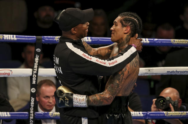 Conor Benn, right, celebrates with Nigel Benn after his WBA Continental Welterweight title boxing match with Steve Jamoye, not pictured, at the O2 Arena, London on Saturday, Oct. 26, 2019. (Paul Harding/PA via AP)