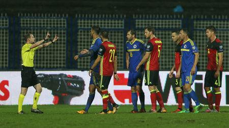 Referee Willie Collum gestures as Bosnia and Belgium players approach him   REUTERS/Dado Ruvic