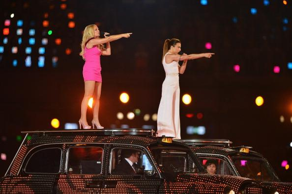 LONDON, ENGLAND - AUGUST 12:  Geri Haliwell (L) and Melanie Chisholm of the Spice Girls perform during the Closing Ceremony on Day 16 of the London 2012 Olympic Games at Olympic Stadium on August 12, 2012 in London, England.  (Photo by Jeff J Mitchell/Getty Images)
