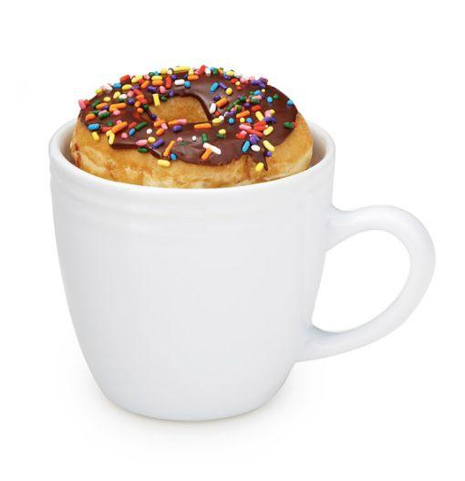 """O M G. <a href=""""https://www.uncommongoods.com/product/donut-warming-mug"""" target=""""_blank"""">Shop it here</a>."""