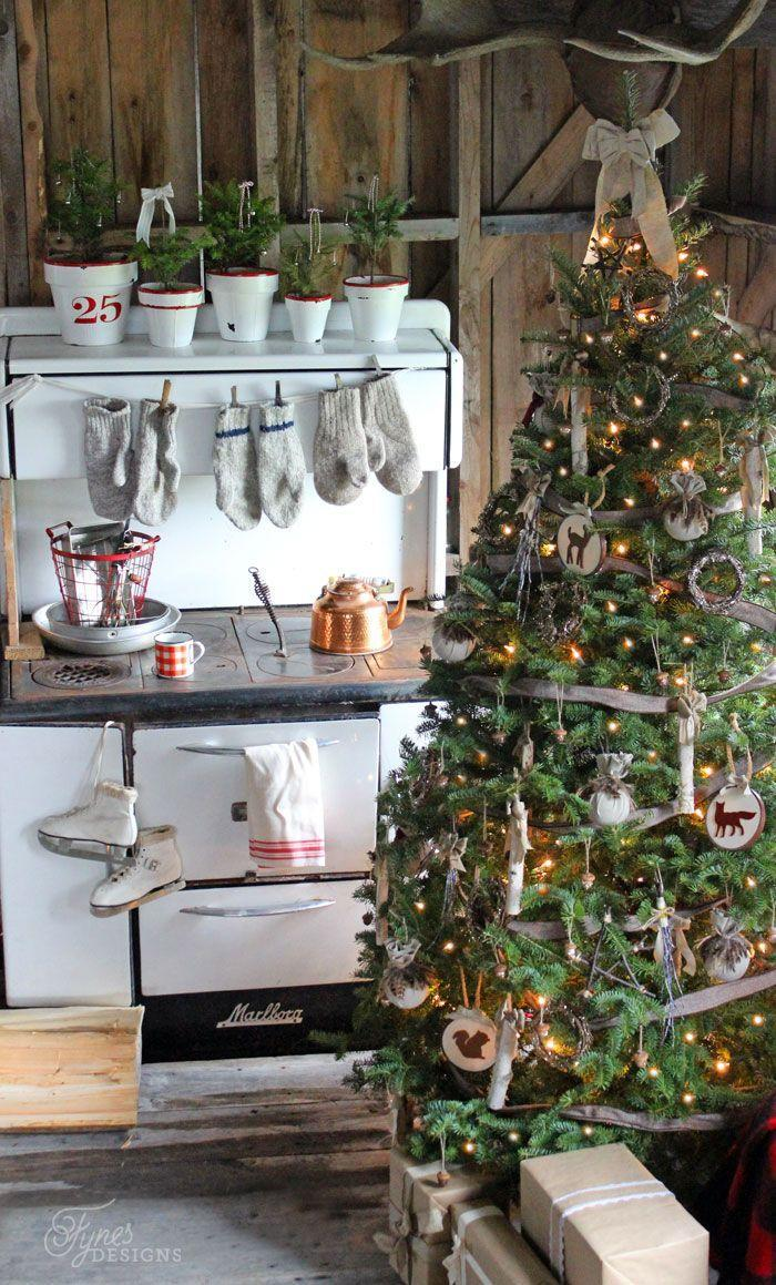 """<p>Instead of purchasing brand-new ornaments, DIY your own with birch sticks, acorns, and burlap.</p><p><em><a href=""""http://www.fynesdesigns.com/rustic-christmas/"""" rel=""""nofollow noopener"""" target=""""_blank"""" data-ylk=""""slk:See more at Fynes Design »"""" class=""""link rapid-noclick-resp"""">See more at Fynes Design »</a></em> <br></p>"""