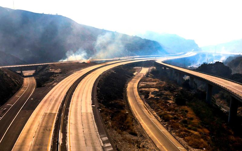 Freeway 5 and 14 are closed to traffic through Newhall Pass due to Saddle Ridge fire in on Friday October 11, 2019. | Irfan Khan/Getty Images