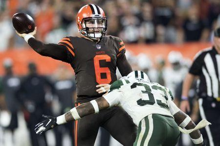 Sep 20, 2018; Cleveland, OH, USA; Cleveland Browns quarterback Baker Mayfield (6) throws a pass under pressure from New York Jets defensive back Jamal Adams (33) during the second half at FirstEnergy Stadium. Mandatory Credit: Ken Blaze-USA TODAY Sports