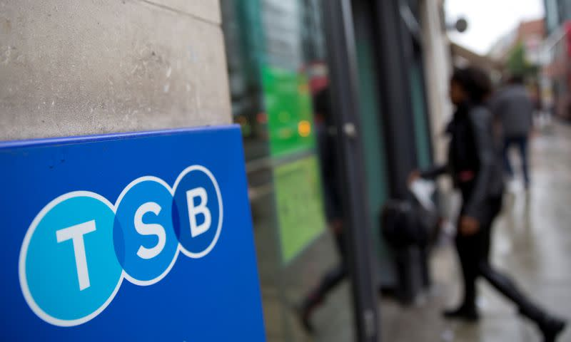 FILE PHOTO: A woman wlalks into a branch of TSB bank in London