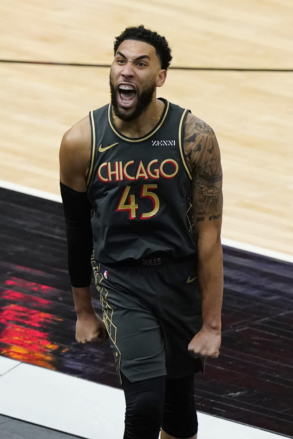 Chicago Bulls guard Denzel Valentine reacts after making a three-point basket during the second half of an NBA basketball game against the Toronto Raptors in Chicago, Sunday, March 14, 2021. (AP Photo/Nam Y. Huh)
