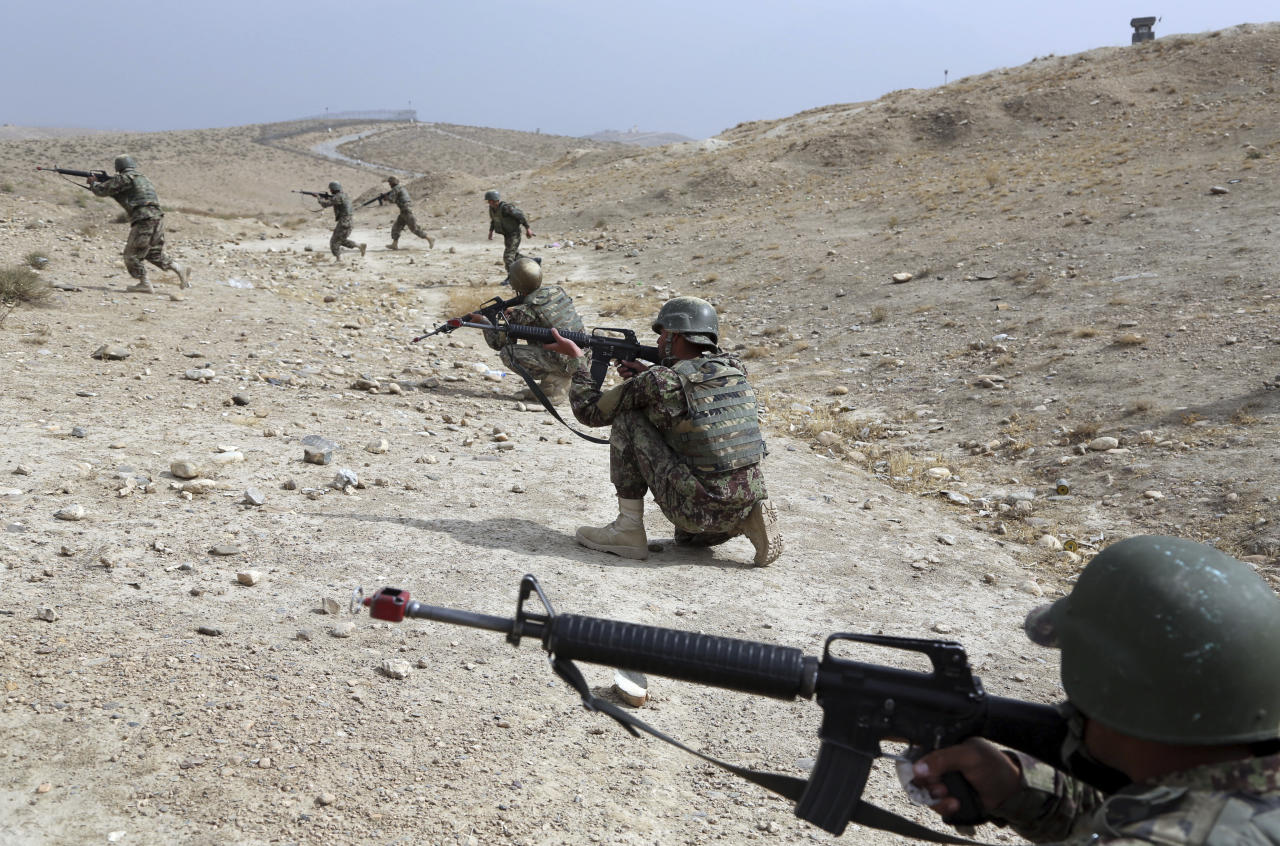 In this Oct. 31, 2018 photo, Afghan National Army soldiers carry out a training exercise at the Afghan Military Academy in Kabul, Afghanistan. When U.S. forces and their Afghan allies rode into Kabul in November 2001 they were greeted as liberators. But after 17 years of war, the Taliban have retaken half the country, security is worse than it's ever been, and many Afghans place the blame squarely on the Americans. (AP Photo/Rahmat Gul)