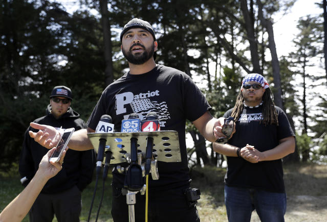 <p>Joey Gibson of the group Patriot Prayer, center, speaks at a news conference in Pacifica, Calif, Saturday, Aug. 26, 2017. (Photo: Marcio Jose Sanchez/AP) </p>