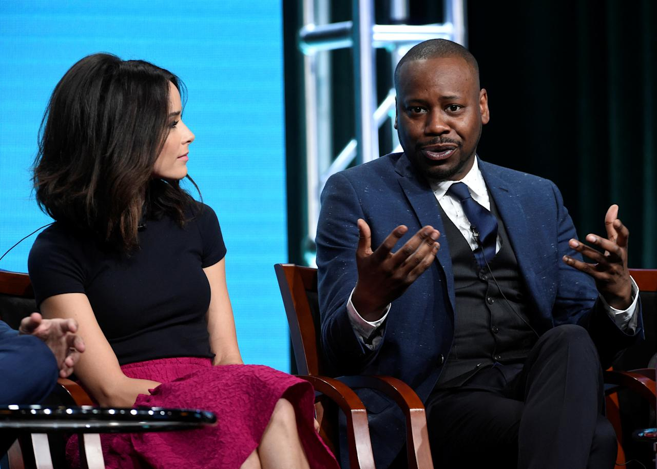 "Cast member Malcolm Barrett (R) and Abigail Spencer (L) answer questions during the panel for ""Timeless"" at the NBC Universal Television Critics Association press tour in Beverly Hills, California, U.S. August 2, 2016.  REUTERS/Phil McCarten"