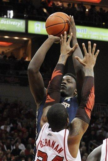 Pittsburgh's Talib Zanna, rear, gets a shot off over Louisville's Chane Behanan during the first half of an NCAA college basketball game Sunday, Feb. 26, 2012, in Louisville, Ky. (AP Photo/Timothy D. Easley)