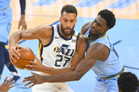 Utah Jazz center Rudy Gobert (27) tries to keep the ball from Memphis Grizzlies forward Jaren Jackson Jr. during the first half of Game 3 of an NBA basketball first-round playoff series Saturday, May 29, 2021, in Memphis, Tenn. (AP Photo/John Amis)