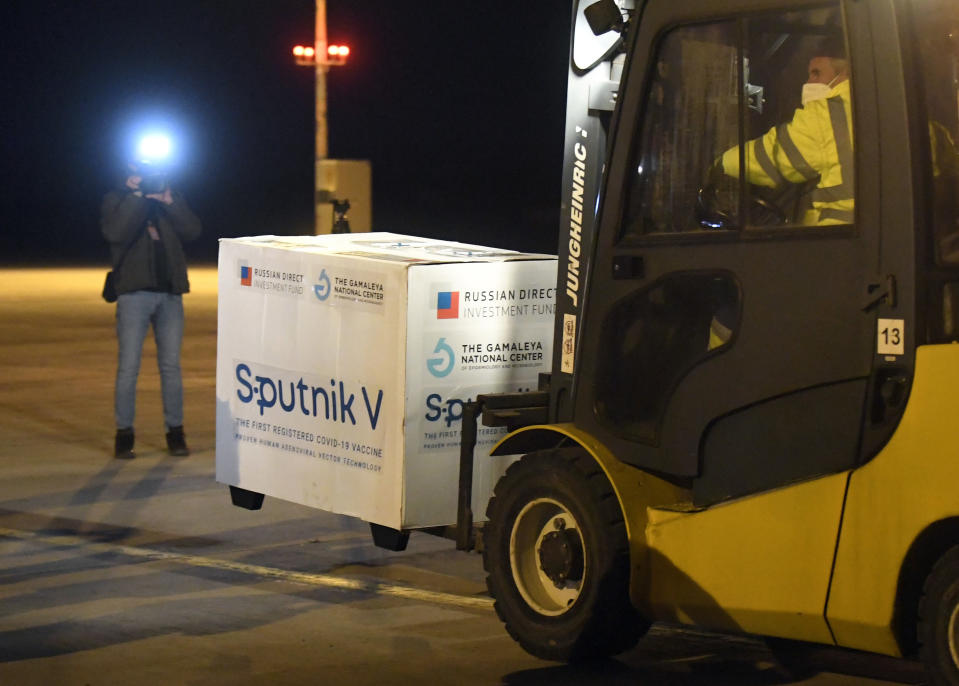 Russia's Sputnik V coronavirus vaccine arrives at Kosice Airport, Slovakia, on Monday March 1, 2021. In a statement Thursday March 4, 2021, the European Medicines Agency regulator says it has started a rolling review of the Sputnik V vaccine that appears to be safe and effective, months after the vaccine was first approved for use in Russia and after dozens of countries around the world have authorized it. (Frantisek Ivan/TASR via AP)