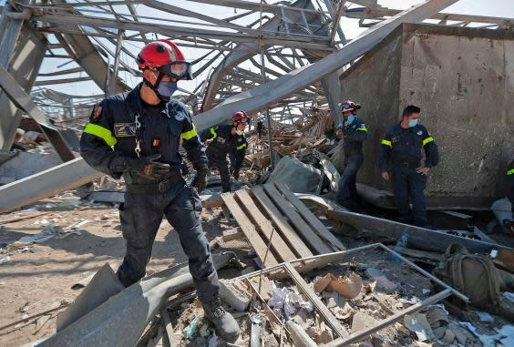 French rescue workers search through the rubble in the devastated Beirut port on Friday (AFP via Getty Images)