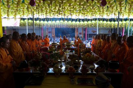 Buddhist monks pray at a temple to mark the eve of the vegetarian festival in Bangkok's Chinatown, Thailand, October 19, 2017. Picture taken October 19, 2017. REUTERS/Athit Perawongmetha
