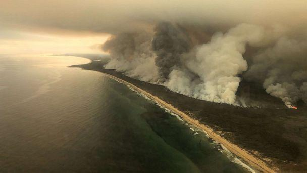 PHOTO: Thick plumes of smoke rise from bushfires at the coast of East Gippsland, Victoria, Australia, Jan. 4, 2020. (Australian Maritime Safety Authority via Reuters)