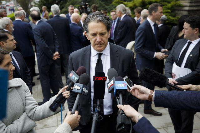 "Toronto Maple Leafs president Brendan Shanahan speaks to the media following the funeral Mass for NHL legend Leonard Patrick ""Red"" Kelly in Toronto, Friday, May 10, 2019. Kelly, a defenseman-turned-center whose Hall of Fame career included eight Stanley Cups while playing for Detroit and Toronto, died Thursday, May 1. He was 91. (Cole Burston/The Canadian Press via AP)"