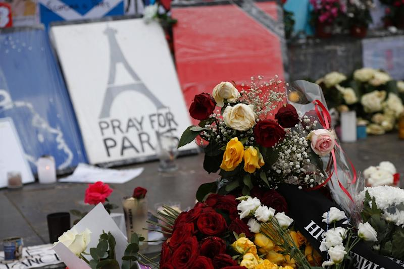 Candles and flowers are placed at a makeshift memorial in Place de la Republique in Paris on December 13, 2015, a month after the Paris terror attacks that claimed 130 lives (AFP Photo/Thomas Samson)