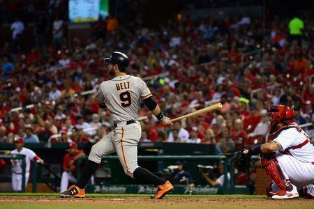 Jun 3, 2016; St. Louis, MO, USA; San Francisco Giants first baseman Brandon Belt (9) hits a one-run single off of St. Louis Cardinals starting pitcher Adam Wainwright (not pictured) during the third inning at Busch Stadium. Mandatory Credit: Jeff Curry-USA TODAY Sports