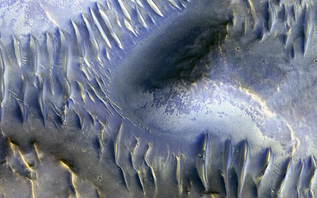 <p>An image taken by the Mars Reconnaissance Orbiter (MRO) and released March 29, 2017 shows a mound that appears to have blocked the path of dunes as they move south. North is to the left in this image. (Photo: NASA/JPL/University of Arizona/Handout via Reuters) </p>