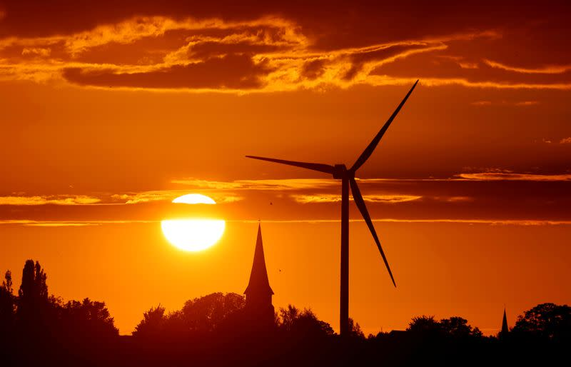 FILE PHOTO: FILE PHOTO: A power-generating windmill turbine is pictured during sunset at a renewable energy park in Ecoust-Saint-Mein, France