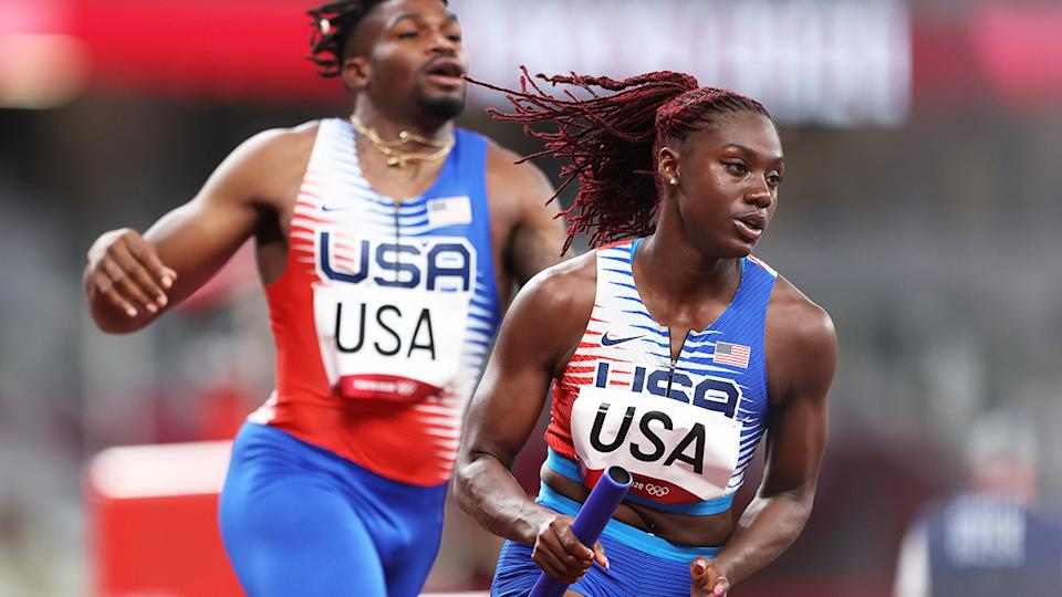 Lynna Irby, pictured here carrying the baton in the 4x400m mixed relay at the Olympics.