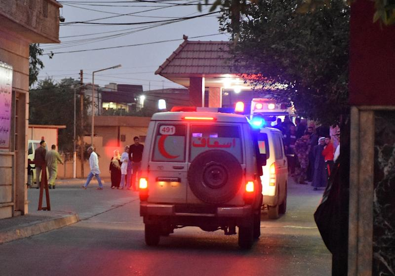 Ambulances drive in the northern Iraqi town of Tuz Khurmatu, carrying the victims of a suicide car bomb attack (AFP Photo/Marwan IBRAHIM)