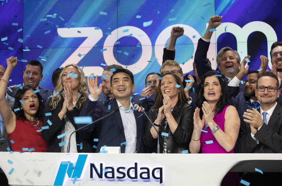 <p> Zoom CEO Eric Yuan, center, celebrates the opening bell at Nasdaq as his company holds its IPO, Thursday, April 18, 2019, in New York. The videoconferencing company is headquartered in San Jose, Calif. (AP Photo/Mark Lennihan)</p>
