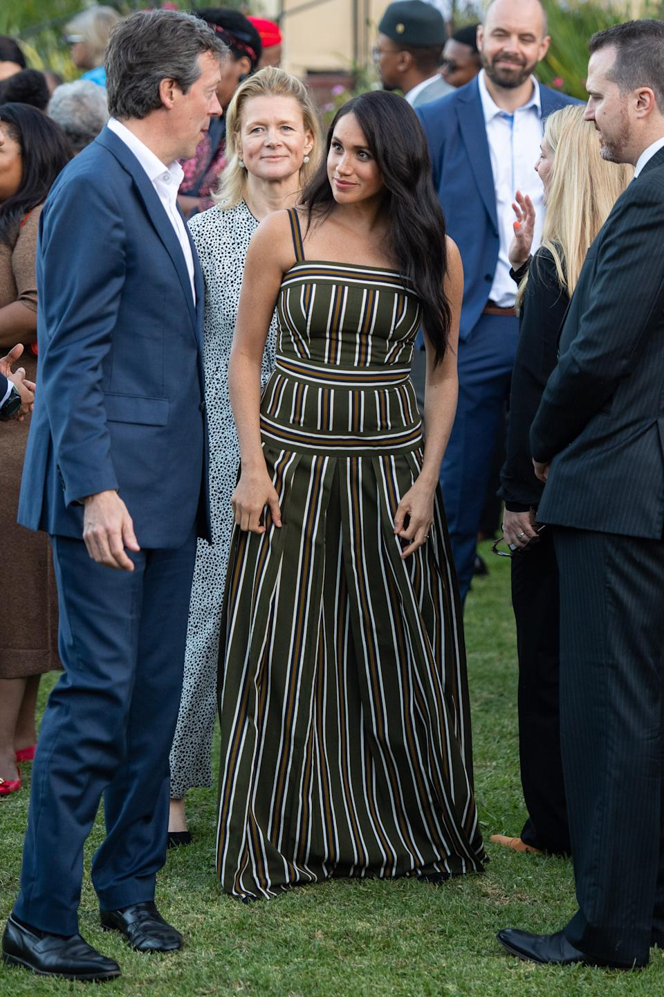 """The Duchess of Sussex opted to recycle her striped Martin Grant maxi dress for the evening reception at the Residence of the British High Commissioner. She styled the look with a pair of black and gold earrings by South African designer, Nina Bosch. The dress is sold out but the earrings are available to buy in four different colours, and retail for £21.49 (R400). <a href=""""https://fave.co/2kQGaM5"""" rel=""""nofollow noopener"""" target=""""_blank"""" data-ylk=""""slk:Shop now"""" class=""""link rapid-noclick-resp""""><strong>Shop now</strong></a><strong>. </strong><em>[Photo: PA]</em>"""