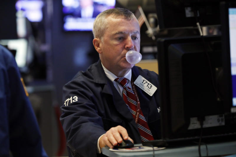 Trader James lamb works on the floor of the New York Stock Exchange, Tuesday, Oct. 8, 2019. Stocks are opening lower on Wall Street as tensions rose between Washington and Beijing just ahead of the latest round of trade talks. (AP Photo/Richard Drew)