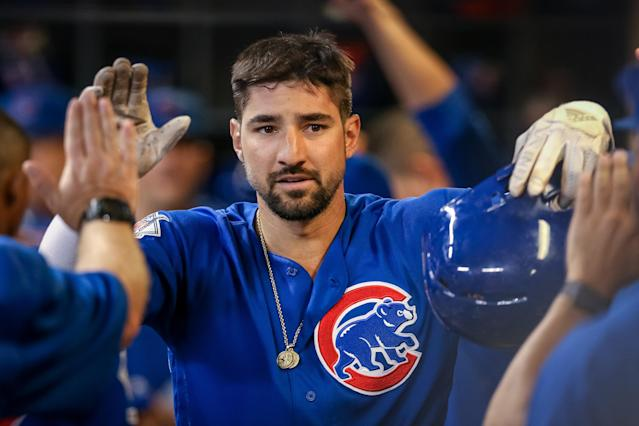 """Nicholas Castellanos #6 of the <a class=""""link rapid-noclick-resp"""" href=""""/mlb/teams/chi-cubs/"""" data-ylk=""""slk:Chicago Cubs"""">Chicago Cubs</a> celebrates with teammates after scoring a run in the fifth inning against the <a class=""""link rapid-noclick-resp"""" href=""""/mlb/teams/milwaukee/"""" data-ylk=""""slk:Milwaukee Brewers"""">Milwaukee Brewers</a> at Miller Park on September 05, 2019 in Milwaukee, Wisconsin. (Dylan Buell/Getty Images)"""