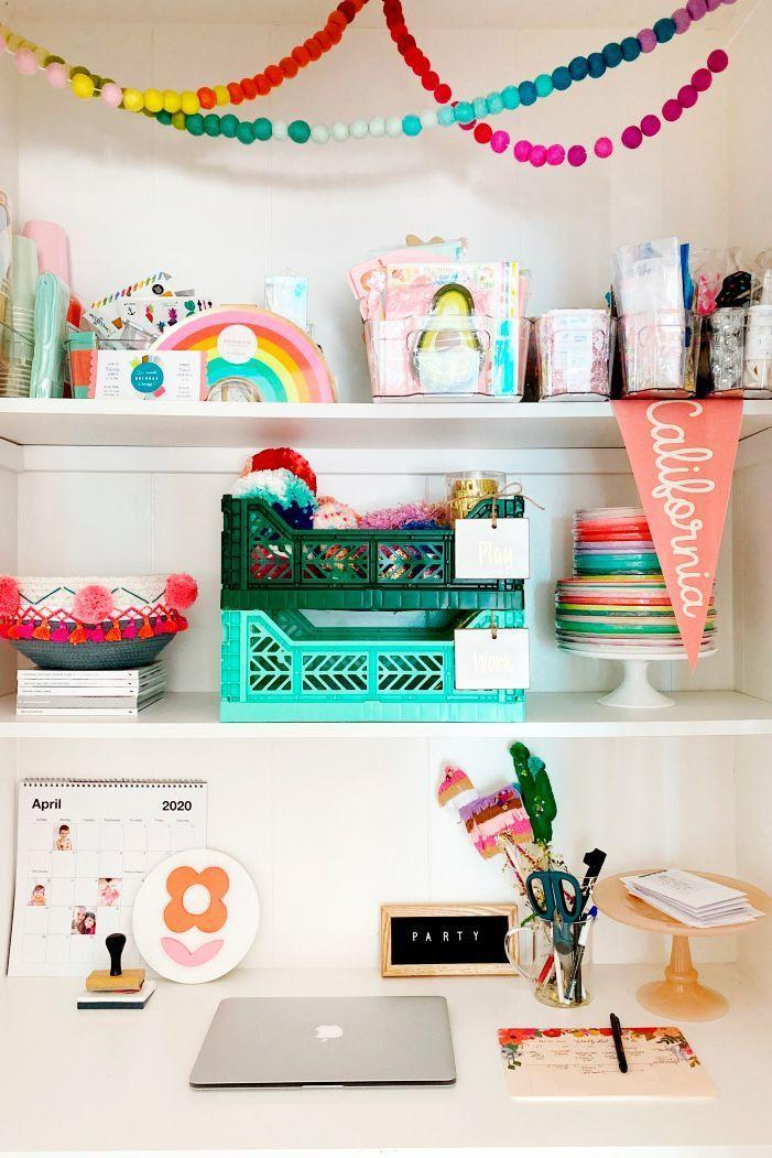 <p>One of the best ways to bring a compact office setup to life is with bold accessories. California-based party stylist Kelsey Klos went with colorful cake stands, rainbow garland, and more to show off her style. <br></p>