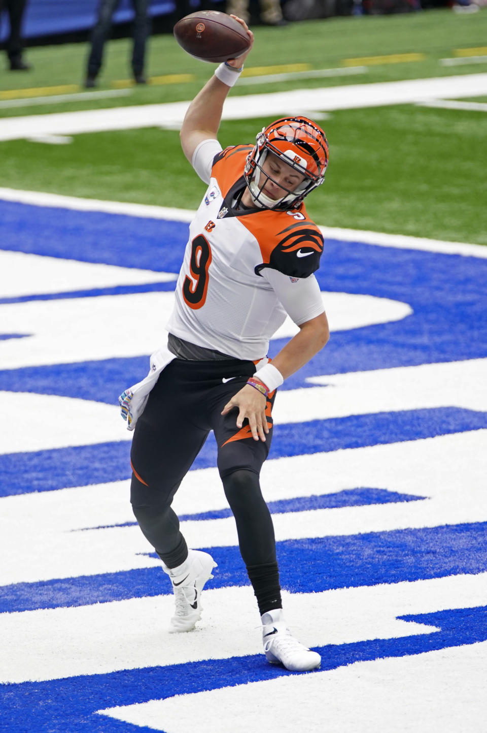 Cincinnati Bengals quarterback Joe Burrow (9) celebrates after rushing for a touchdown during the first half of an NFL football game against the Indianapolis Colts, Sunday, Oct. 18, 2020, in Indianapolis. (AP Photo/AJ Mast)